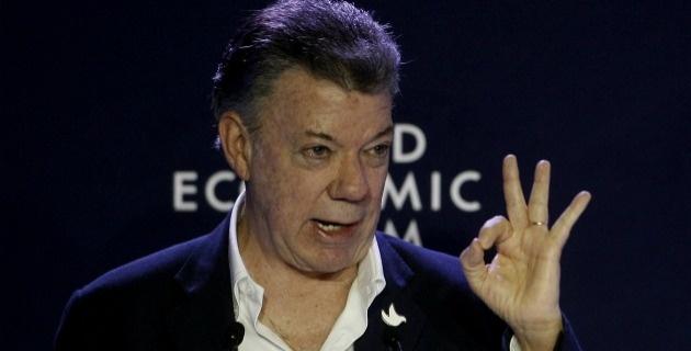 Santos amenaza a los colombianos